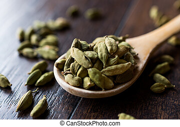 Cardamom Seeds in Wooden Spoon.