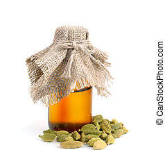 Cardamom with a pharmaceutical bottle. Isolated.