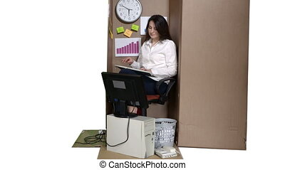 Cardboard box as a very small office business woman working on desktop computer