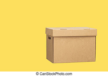 Cardboard box isolated on a yellow background