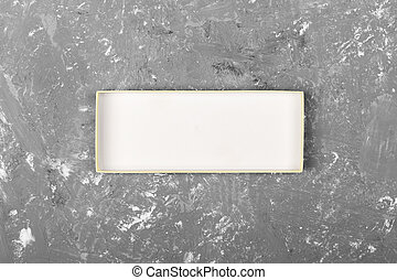 cardboard box on gray cement background surface. top view blank for you design