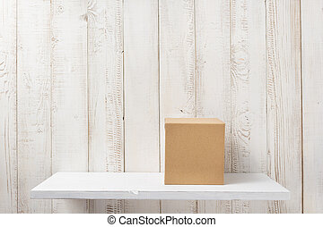 cardboard box on wooden shelf - cardboard box on white...
