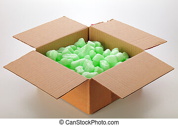 Cardboard box - A cardboard box with green packing styrofoam...