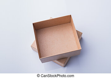Cardboard box pieces in column, top view.