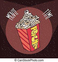 Cardboard box with popcorn in beams spotlights