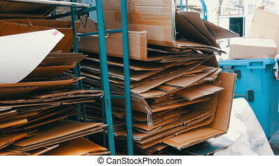 Cardboard boxes folded for further processing. Garbage ...