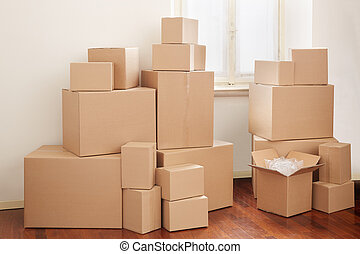 Cardboard boxes in apartment