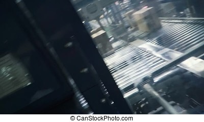 Cardboard boxes on conveyor belt in factory. Clip. Packing...