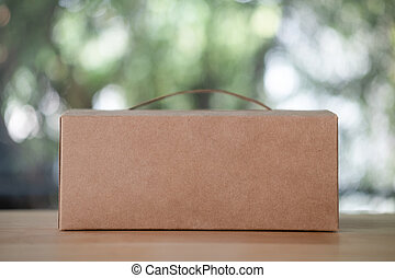 Cardboard brown box with handle