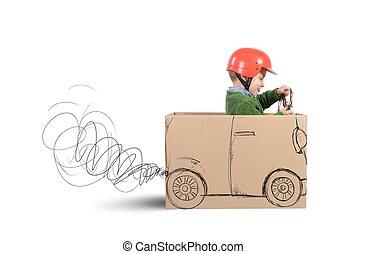 Cardboard car - Creative baby plays with his cardboard car