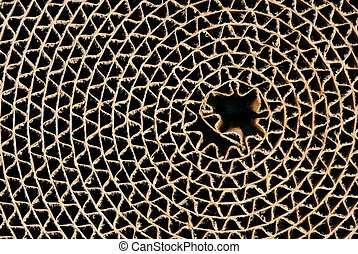Cardboard Circle - Webbed circle made of brown corrugated...