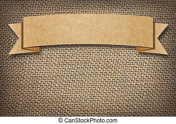 Cardboard Label on burlap background with space