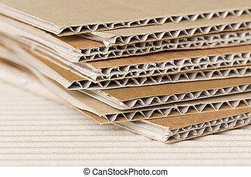 Cardboard pile on corrugated fiber board background