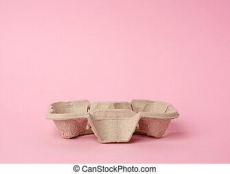cardboard recycle stand for hot drinks for two cups is on a pink background