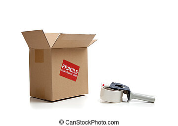 Cardboard shipping box with a tape gun on a white background
