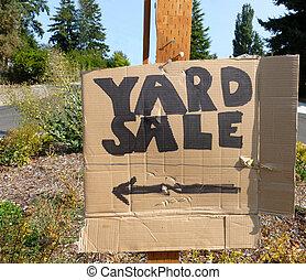 Cardboard yard Sale Sign - A cardboard sign on a street...