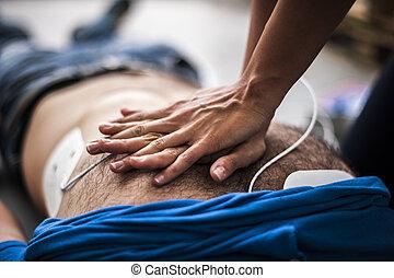 cardiac resuscittion assistance - rescuer making cardiac...