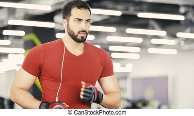 Cardio Exercise in the Gym - Muscular handsome man wears in...