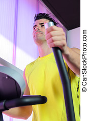 Cardio in Elliptical - Man training cardio with elliptical...
