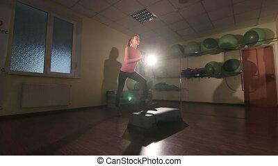 Cardio step aerobics dance workout in gym
