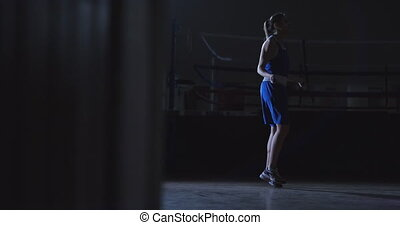 Cardio training for fighters. Young beautiful woman...