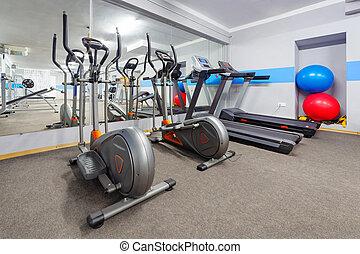 Cardio zone in modern gym.