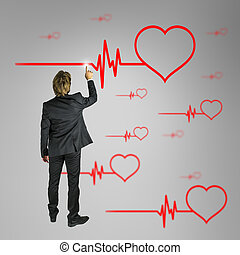 Cardiology concept - Male cardiologist choosing heart shape...