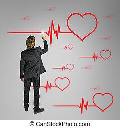 Cardiology concept - Male cardiologist choosing heart shape...