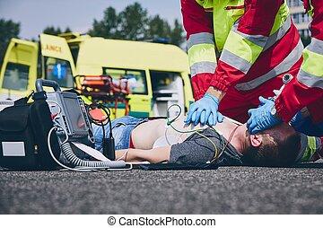 Cardiopulmonary resuscitation on road