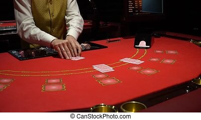 Cards being dealt at poker game in casino