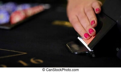 Cards being played at a blackjack table. close up