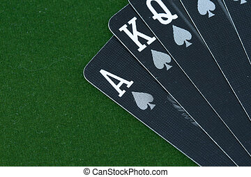 cards in front of a green