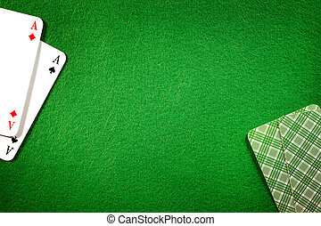 Cards on green felt casino table background