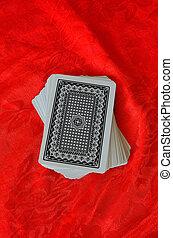 cards on red felt poker table