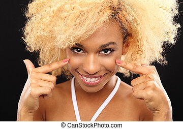 Care delicate skin around the eyes - Dark skinned woman's...
