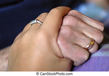 Hands of young and old lady