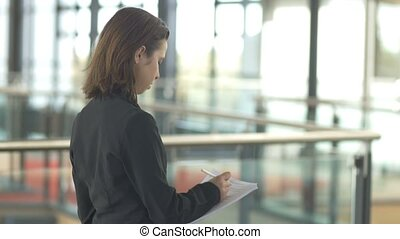 Career corporate business woman working writing in office building