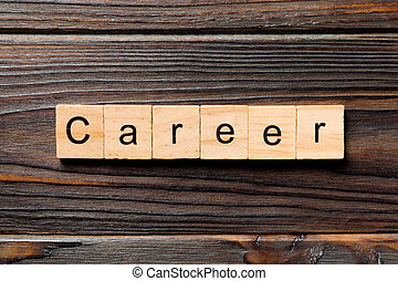 Career word written on wood block. Career text on wooden table for your desing, Top view concept