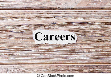 careers of the word on paper. concept. Words of careers on a wooden background