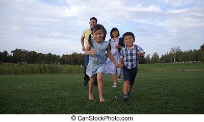 Carefree asian family enjoying leisure in nature