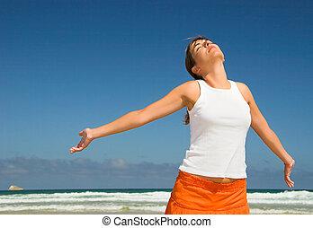 Carefree - Beautiful woman in the beach