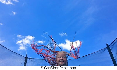 carefree childhood, happy summer. beautiful girl with African pigtails jumping on a trampoline - slow motion