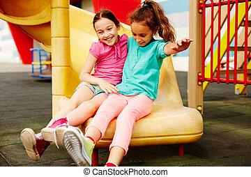 Carefree childhood - Image of two friendly girls having fun...