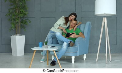 Carefree couple using digital tablet together