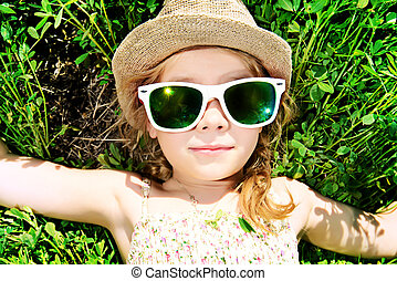 carefree - Cute little girl on a meadow in summer day. Happy...