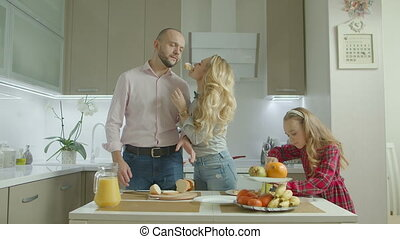 Carefree family preparing breakfast in the kitchen