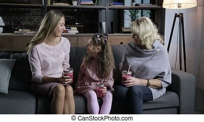 Carefree family spending leisure on the sofa