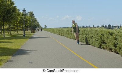 Carefree female enjoying freeride on roller blades - Active...