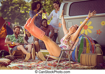 Carefree hipster having fun on campsite