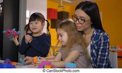 Carefree kids enjoying playtime in kindergarten - Carefree...